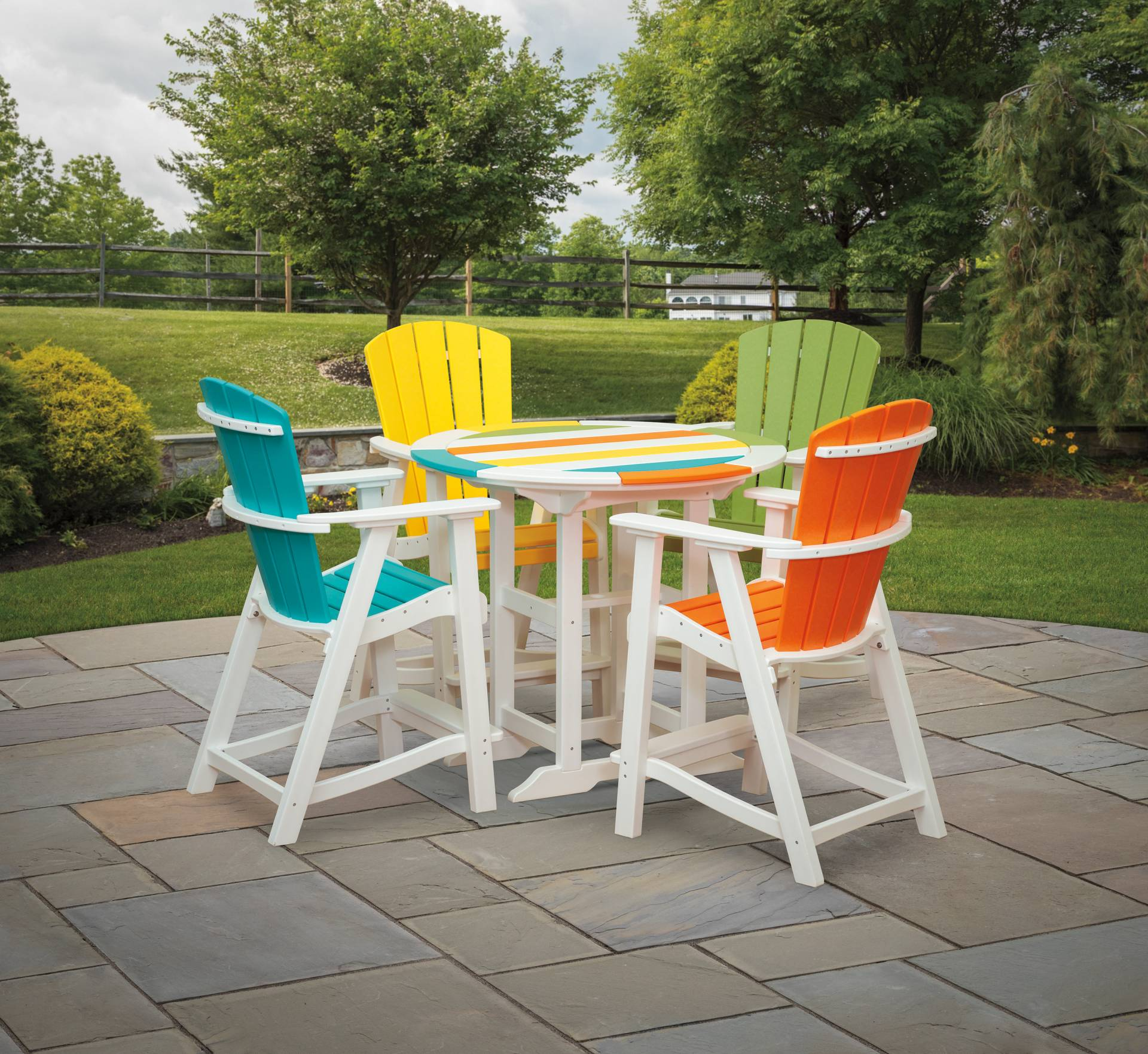 multi-colored polywood balcony chairs and round table
