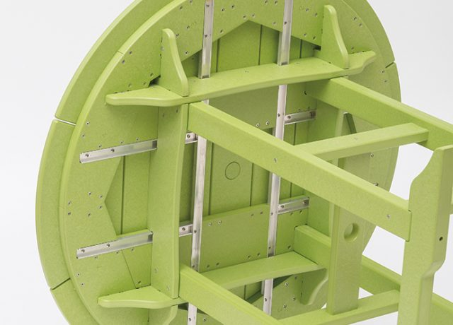underside view of green round bar table